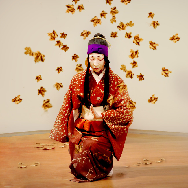 Prayer kneeling with golden leaves